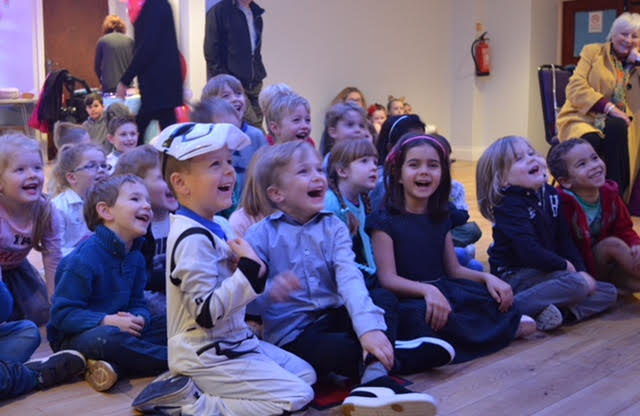 Children laughing and having a great time at Ritchie Rosson's magic show 2018