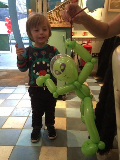 Alien balloon for a happy boy at Ritchie's party